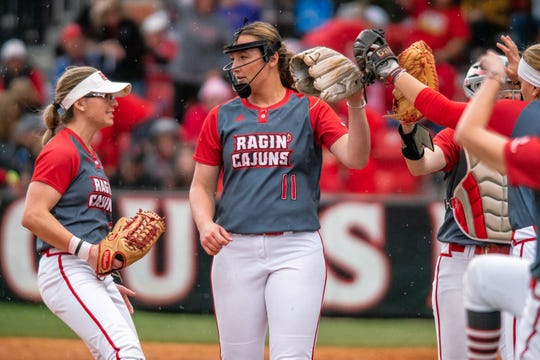 UL's Megan Kleist is congratulated after the inning as the Ragin' Cajuns take on the LSU Tigers at Yvette Girouard Field on Saturday, Feb. 15, 2020.