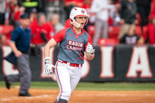 Ragin' Cajuns first baseman Sarah Hudek celebrates her home run in UL's win over LSU last Saturday at Lamson Park.