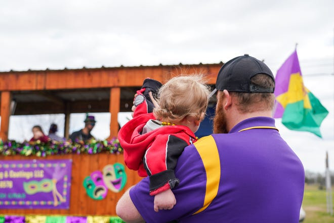The Carencro Mardi Gras Parade rolls through town from Carencro High School to the Carencro Community Center Saturday, Feb. 15, 2020.