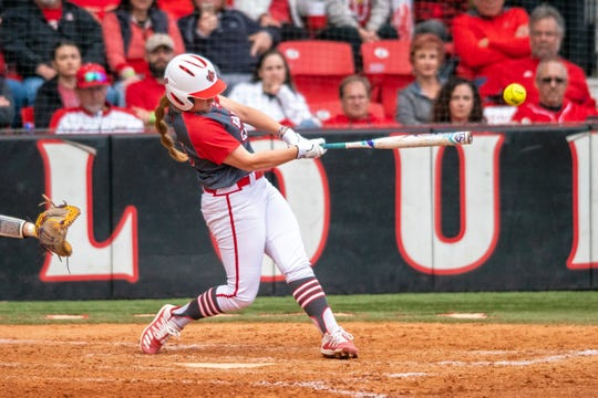 UL's Carrie Boswell hits the ball high as the Ragin' Cajuns take on the LSU Tigers at Yvette Girouard Field on Saturday, Feb. 15, 2020.