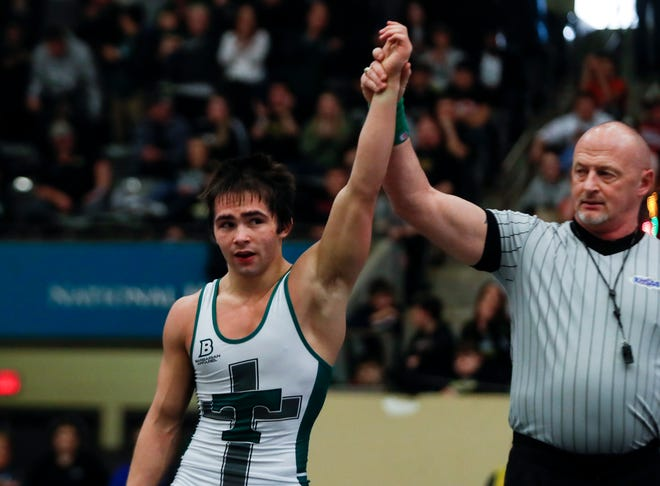 Trinity's Ty Lehman wins the KHSAA wrestling championship in the 145 weight division against Union County's Trevor Pogue on Feb. 15, 2020.
