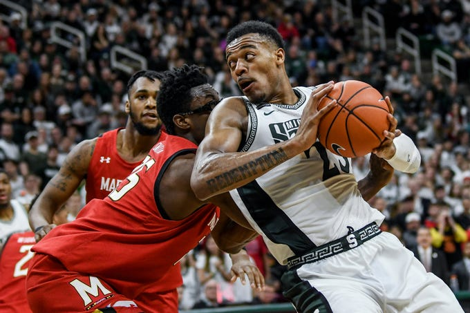 Michigan State's Xavier Tillman, right, moves around Maryland's Jalen Smith during the second half on Saturday, Feb. 15, 2020, at the Breslin Center in East Lansing.