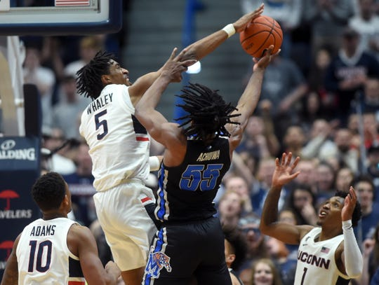 UConn forward Isaiah Whaley (5) blocks a shot by Memphis' Precious Achiuwa (55) in Sunday's game.