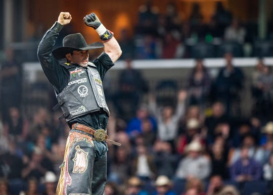 Fabiano Vieira celebrates after a successful ride on bull Whipper Snapper during the Professional Bull Riders Pendleton Whisky Velocity Tour at the FedExForum on Saturday, February 15, 2020.