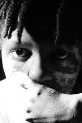 """University School of Milwaukee ninth-grader Lauryn Dixon won a gold key in photography for """"The Pain Cannot be Silenced."""""""
