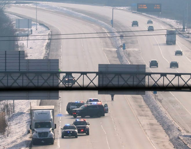 Wisconsin State Patrol and Waukesha County sheriff's officers investigate a fatal accident scene Sunday morning on Interstate 94 east of Barker Road in Waukesha County, where a pedestrian was killed. All westbound traffic was diverted off the freeway at Moorland Road starting around 6:20 a.m. Sunday.