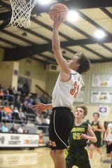 Calico Rock's Carter Hiles goes up for two of his 23 points during the Junior Pirates' district championship victory.