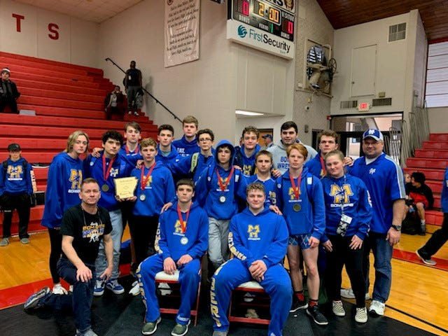 The Mountain Home Bombers took home the runner-up trophy at the 5A-East Conference wrestling tournament on Saturday at Searcy.