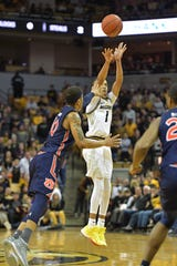 Missouri guard Xavier Pinson (1) shoots a 3-pointer over Auburn guard Samir Doughty (10) defends on Feb. 15, 2020, in Columbia, Mo.