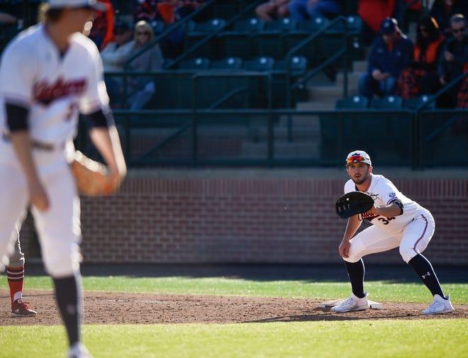 Auburn football tight end John Samuel Shenker, who is playing baseball this season, plays first base against Illinois-Chicago on Feb. 15, 2020, at Plainsman Park.