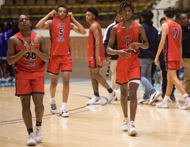 Pike Road players react after losing to Pike County during the Class 3A boys Southeast Regional semifinal at Garrett Coliseum in Montgomery, Ala., on Saturday, Feb. 15, 2020. Pike County defeated Pike Road 77-73.