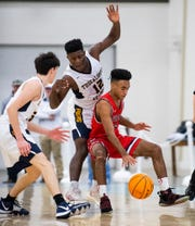 Pike's Jacon Christian (13) is double teamed by Tuscaloosa's Phil McDuff (12) and Sam Rowley (14) in AISA Class AAA championship action in Montgomery, Ala., on Saturday February 15, 2020.