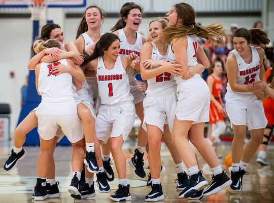 Lee-Scott players celebrate winning the AISA Class AAA Girls Basketball State Championship in Montgomery, Ala., on Saturday February 15, 2020.
