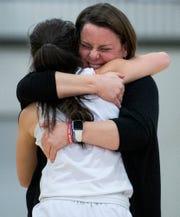 Lee-Scott coach Corye Ivatt hugs Mary Mykal Prewett (1) as they celebrate winning the AISA Class AAA Girls Basketball State Championship in Montgomery, Ala., on Saturday February 15, 2020.