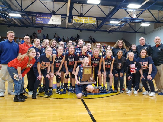 The Blue River girls basketball team poses for a picture after beating Northfield 39-34 for its first-ever regional title on Feb. 15, 2020.