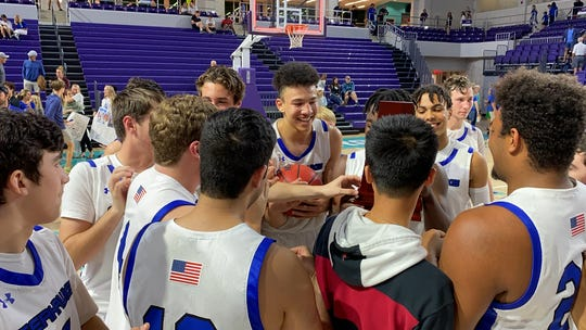 The Community School boys basketball team celebrates a 70-57 win over Canterbury in the District 3A-8 championship game Feb. 15, 2020 at Suncoast Credit Union Arena in Fort Myers.