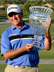 Scott Parel holds the trophy after winning the 2020 Chubb Classic in Naples on Sunday, Feb.16, 2020.