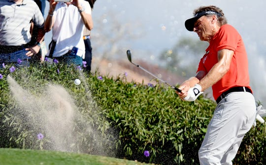 Bernhard Langer hits out of the sand on the 8th hole during the final round of the Chubb Classic at the Lely Resort in Naples on Sunday, Feb.16, 2020.