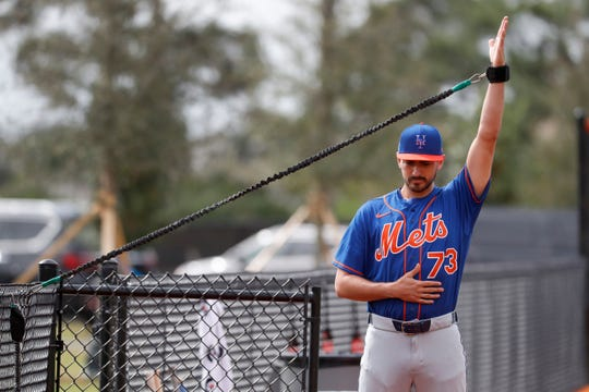 New York Mets pitcher Daniel Zamora stretches during spring training baseball practice Saturday, Feb. 15, 2020, in Port St. Lucie, Fla.