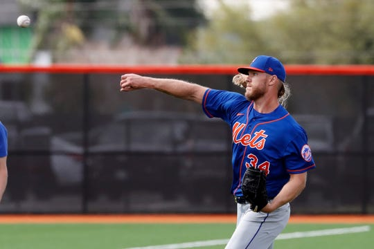 New York Mets pitcher Noah Syndergaard throws during spring training baseball practice Saturday, Feb. 15, 2020, in Port St. Lucie, Fla.