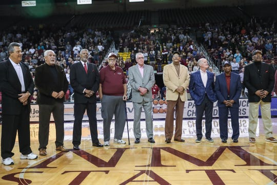 The 1970's Amazin' Aggies visit the court at half time as the New Mexico State Aggies face off against the Utah Valley Wolverines at the Pan American Center in Las Cruces on Saturday, Feb. 15, 2020.
