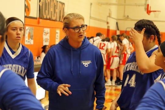 Bonnie McKenzie talks to her basketball team during the 202 Border Championship at the Artesia Park Junior High gymnasium.
