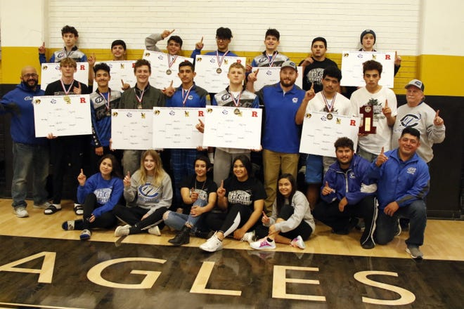 Carlsbad's wrestling team poses after winning the District 4-5A Championship in Hobbs on Feb. 15, 2020. Carlsbad had 11 district champs and will be sending 12 boys and five girls to the state tournament in Rio Rancho on Feb. 21.