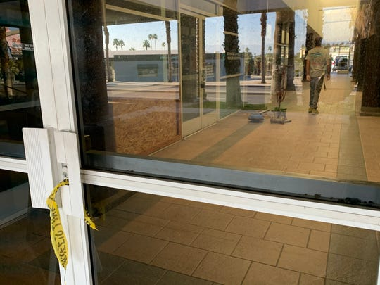 Remnants of security tape hang outside a Rancho Mirage medical complex where a murder-suicide took place February 14, 2020 in the 71-500 block of Highway 111. Cleaning crews were clearing the area two days later.
