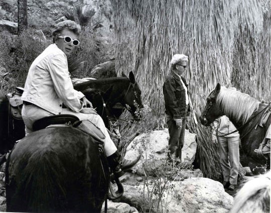 Marj Krall, Jane Hoff with horses in canyon in the 1970s.