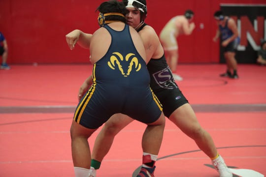 Shadow Hills Juan Ocegueda wrestles Santos Salas of Millikan during the CIF-SS Boys' Individual Wrestling Championships in Palm Springs, Calif., on Saturday, February 15, 2020.