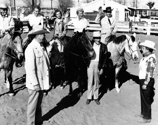 The Desert Riders are sworn in at the beginning of 1970. Marj Krall, second from the left, Clare Woodmansee, Jane Lykken Hoff and Art Smith sit mounted on their horses. Standing Boo Hoff, Carl Lykken and Ed McCoubrey stand in front of them.