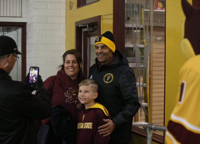 ASU's football head coach Herm Edwards poses for pictures with fans during a hockey game at Oceanside Ice Arena in Tempe, Ariz. on Feb. 15, 2020.