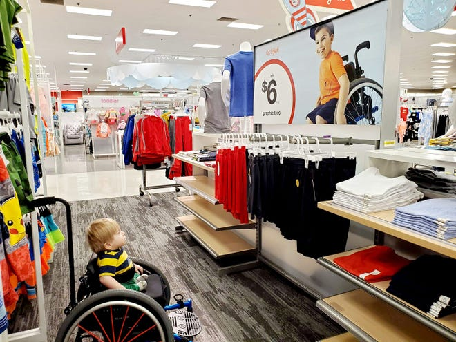 Demi Garza-Pena shared this photo of her son, Oliver, staring in awe at a Target ad in Peoria because he recognized a boy just like him, she said.