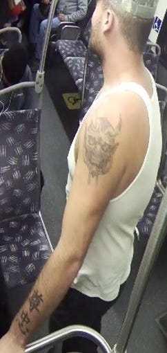 Suspect has a demon tattoo on his left shoulder and Asian symbols on his left forearm.