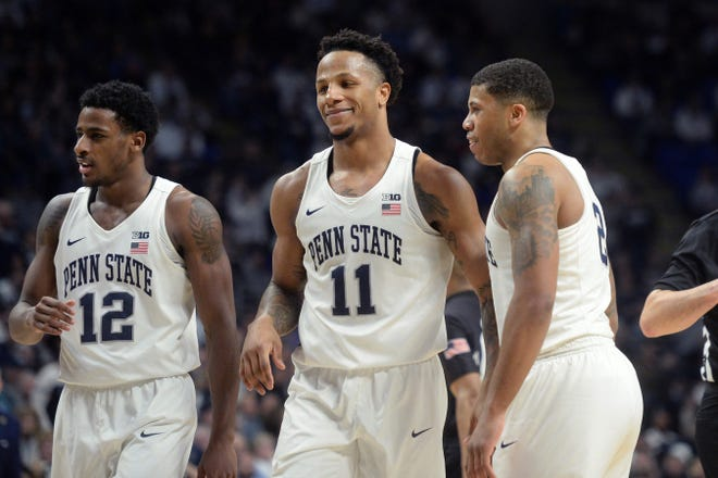 Penn State's Lamar Stevens (11) reacts with Izaiah Brockington (12) and Myles Dread after a foul during the second half of an NCAA college basketball game against Northwestern, Saturday, Feb. 15, 2020, in State College, Pa. (AP Photo/Gary M. Baranec)