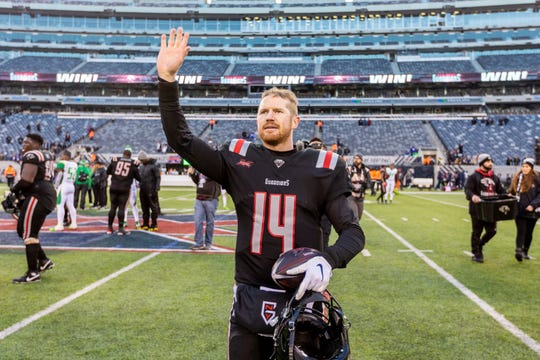 New York Guardians quarterback Matt McGloin celebrates the 23-3 win after an XFL football game against the Tampa Bay Vipers, Sunday, Feb. 9, 2020, in East Rutherford, N.J. (Joe Hermitt/The Patriot-News via AP)