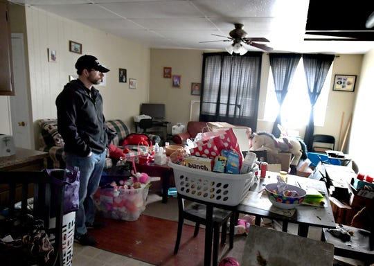 Aaron Kohler stands in a friend's home at Hilltop Apartments in Red Lion, Sunday, Feb. 16, 2020, after it was damaged by a fire which started just before midnight on Saturday. Bill Kalina photo