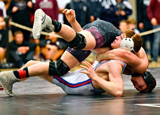 Gettysburg's Dylan Reinert, seen here at top in a file photo, finished third in the PIAA Class 3-A Wrestling Championships at 171 pounds this season.