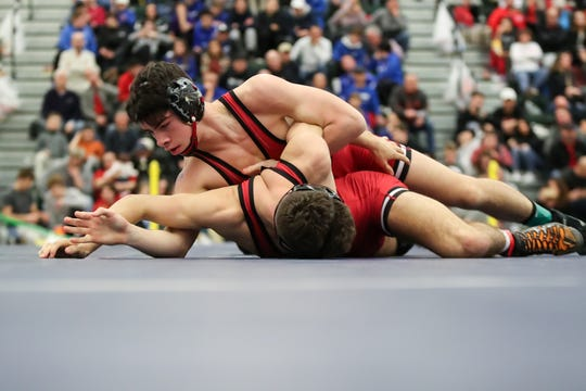 Ryan Burgos of Hilton tries to get wrist control over his teammate Ryan Hinman in the Division I 138 pound championship in the SERC center at SUNY Brockport on Feb. 15, 2020.