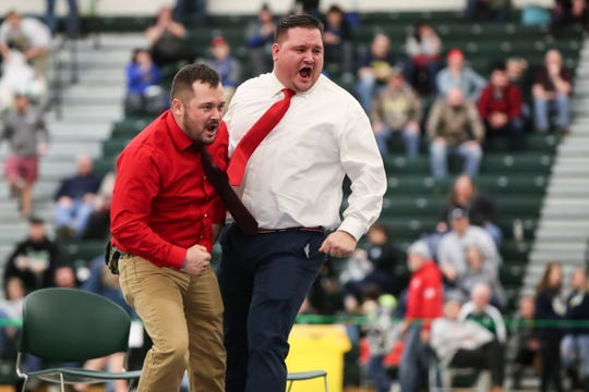 Bolivar-Richburg coaches celebrate after Hudson Evingham defeats Nate DeGroff of Warsaw in the Division II 195 pound championship in the SERC center at SUNY Brockport on Feb. 15, 2020.