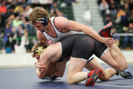 Brock Conaway of Perry grabs the leg of Sam Halstead of Williamson/Marion/Sodus in the Division II 182 pound championship in the SERC center at SUNY Brockport on Feb. 15, 2020.