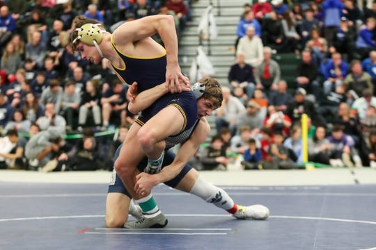 Nick Sanko of Pittsford keeps leg control on Mason Wersinger of Spencerport in the 145-pound division at the Section V state qualifier at SUNY Brockport on Feb. 15. Both Sanko and Wersinger qualified for the state tournament.