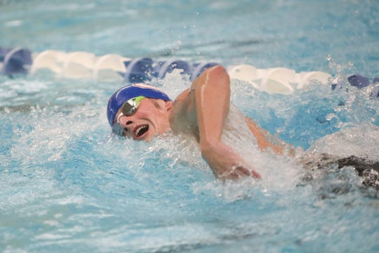 South Salem's Benjamin Miramon competes in the boys 200-yard freestyle at the 2020 Mountain Valley Conference district swim championship on February 15 at the Kroc Center.