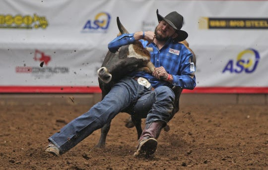 Bridger Chambers competes in the steer wrestling event during the Cinch Chute-Out at the San Angelo Stock Show and Rodeo on Saturday, Feb. 15, 2020.