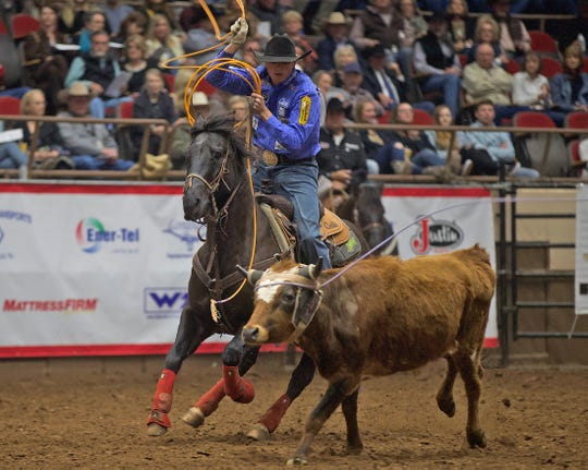Wesley Thorp competes in the team roping event at the Cinch Chute-Out at the San Angelo Stock Show and Rodeo on Saturday, Feb. 15, 2020.