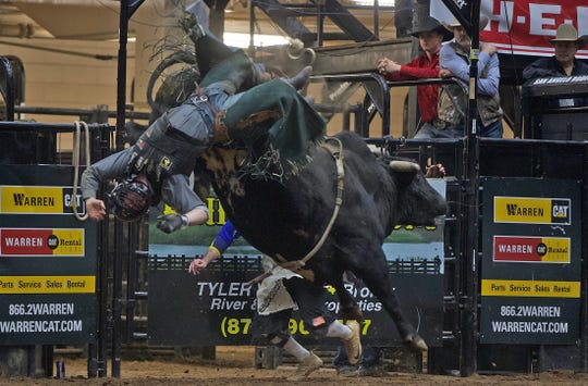 Trey Benton III is thrown from a bull during the bull riding event at the Cinch Chute-Out at the San Angelo Stock Show and Rodeo on Saturday, Feb. 15, 2020.