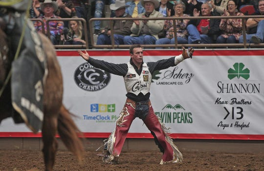 Tim O'Connell celebrates after competing in the bareback event at the Cinch Chute-Out at the San Angelo Stock Show and Rodeo on Saturday, Feb. 15, 2020.