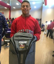 North DeSoto's Josh Sarpy gets his Times Athlete of the Week backpack..