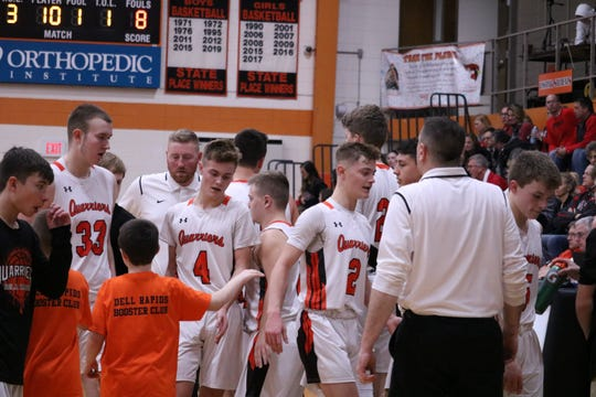 Ramsey Heinecke (33), Colin Rentz (4) and Connor Rentz (2) break the huddle at a home game earlier this season. The Quarriers are now 12-4 after an 87-60 win over Rapid City Christian.