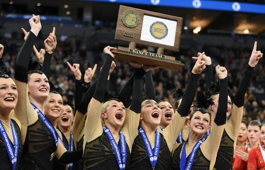 Sartell dancers celebrate their fourth-straight Class 2A state high kick championship Saturday, Feb. 15, 2020, at the Target Center in Minneapolis.